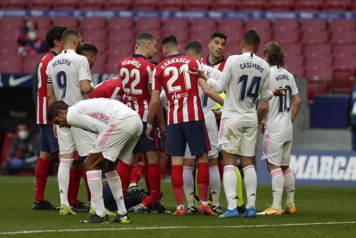 Players confront each other during the Spanish La Liga soccer match between Atletico Madrid and Real Madrid at the Wanda Metropolitano stadium in Madrid, Spain, Sunday, March 7, 2021. (AP Photo/Manu Fernandez)