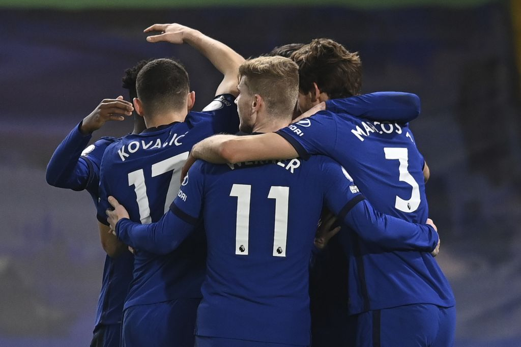 Chelsea players celebrate after Everton's Ben Godfrey scored an own goal during the English Premier League soccer match between Chelsea and Everton at the Stamford Bridge stadium in London, Monday, March 8, 2021. (Glyn Kirk/Pool via AP)