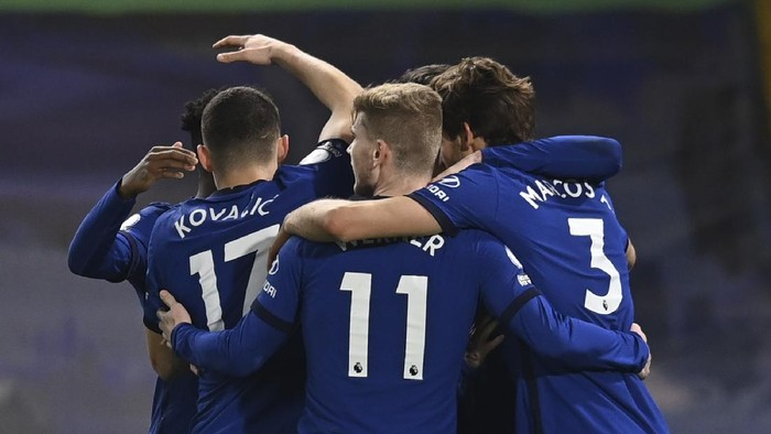 Chelsea players celebrate after Evertons Ben Godfrey scored an own goal during the English Premier League soccer match between Chelsea and Everton at the Stamford Bridge stadium in London, Monday, March 8, 2021. (Glyn Kirk/Pool via AP)