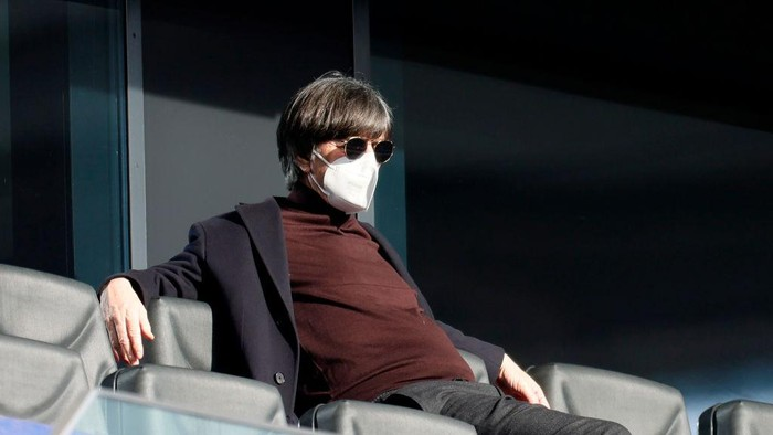 FRANKFURT AM MAIN, GERMANY - FEBRUARY 20: Joachim Loew, Head Coach of Germany looks on from the stands prior to the Bundesliga match between Eintracht Frankfurt and FC Bayern Muenchen at Deutsche Bank Park on February 20, 2021 in Frankfurt am Main, Germany. Sporting stadiums around Germany remain under strict restrictions due to the Coronavirus Pandemic as Government social distancing laws prohibit fans inside venues resulting in games being played behind closed doors. (Photo by Ronald Wittek - Pool/Getty Images)