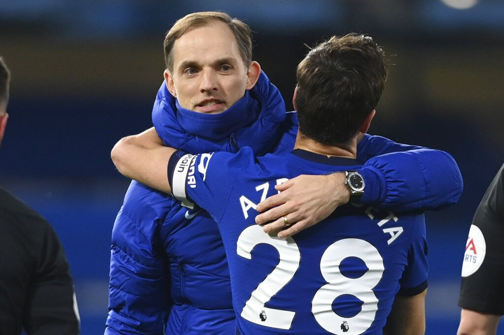 Chelsea's head coach Thomas Tuchel embraces Chelsea's Cesar Azpilicueta at the end of the English Premier League soccer match between Chelsea and Everton at the Stamford Bridge stadium in London, Monday, March 8, 2021. (Mike Hewitt/Pool via AP)