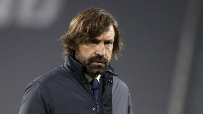Juventus head coach Andrea Pirlo walks on the pitch during warmup before the Champions League, round of 16, second leg, soccer match between Juventus and Porto in Turin, Italy, Tuesday, March 9, 2021. (AP Photo/Luca Bruno)
