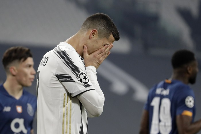 Juventus' Cristiano Ronaldo reacts during the Champions League, round of 16, second leg, soccer match between Juventus and Porto in Turin, Italy, Tuesday, March 9, 2021. (AP Photo/Luca Bruno)