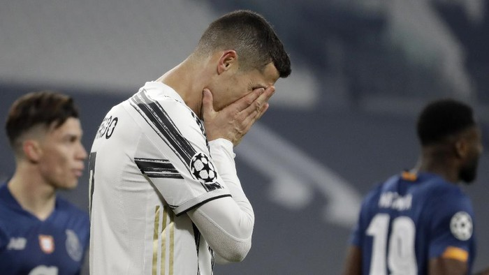 Juventus Cristiano Ronaldo reacts during the Champions League, round of 16, second leg, soccer match between Juventus and Porto in Turin, Italy, Tuesday, March 9, 2021. (AP Photo/Luca Bruno)