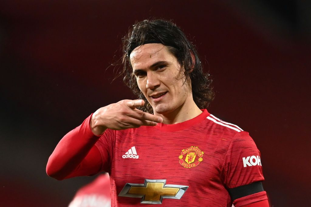 MANCHESTER, ENGLAND - FEBRUARY 06:  Edinson Cavani of Manchester United celebrates after scoring their team's first goal during the Premier League match between Manchester United and Everton at Old Trafford on February 06, 2021 in Manchester, England. Sporting stadiums around the UK remain under strict restrictions due to the Coronavirus Pandemic as Government social distancing laws prohibit fans inside venues resulting in games being played behind closed doors. (Photo by Michael Regan/Getty Images)