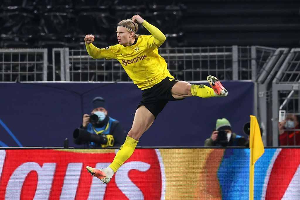 DORTMUND, GERMANY - MARCH 09: Erling Haaland of Borussia Dortmund celebrates after scoring their side's second goal from the penalty spot during the UEFA Champions League Round of 16 match between Borussia Dortmund and Sevilla FC at Signal Iduna Park on March 09, 2021 in Dortmund, Germany. Sporting stadiums around Germany remain under strict restrictions due to the Coronavirus Pandemic as Government social distancing laws prohibit fans inside venues resulting in games being played behind closed doors. (Photo by Lars Baron/Getty Images)