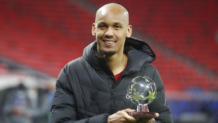 Liverpools Fabinho holds the player of the match trophy after the Champions League round of 16 second leg soccer match between Liverpool and RB Leipzig at the Puskas Arena stadium in Budapest, Hungary, Wednesday, March 10, 2021. (AP Photo/Laszlo Balogh)