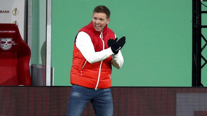 Leipzigs head coach Julian Nagelsmann gestures during the German soccer cup, DFB Pokal, quarter final match between RB Leipzig and VfL Wolfsburg in Leipzig, Germany, Wednesday, March 3, 2021. (AP Photo/Michael Sohn)