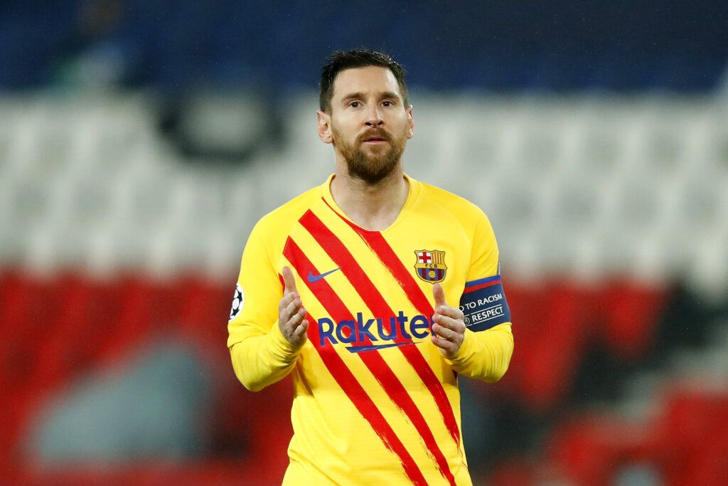Barcelona's Lionel Messi reacts after a missed scoring opportunity during the Champions League, round of 16, second leg soccer match between Paris Saint-Germain and FC Barcelona at the Parc des Princes stadium in Paris, Wednesday, March 10, 2021. (AP Photo/Christophe Ena)