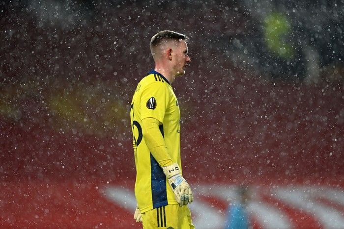 MANCHESTER, ENGLAND - MARCH 11: Dean Henderson of Manchester United looks on as rain falls during the UEFA Europa League Round of 16 First Leg match between Manchester United and A.C. Milan at Old Trafford on March 11, 2021 in Manchester, England. Sporting stadiums around the UK remain under strict restrictions due to the Coronavirus Pandemic as Government social distancing laws prohibit fans inside venues resulting in games being played behind closed doors. (Photo by Laurence Griffiths/Getty Images)