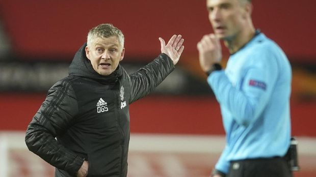 Manchester United's manager Ole Gunnar Solskjaer reacts during the Europa League round of 16 first leg soccer match between Manchester United and AC Milan at Old Trafford in Manchester, England, Thursday, March 11, 2021. (AP Photo/Dave Thompson)