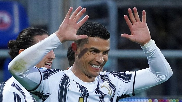 Juventus Cristiano Ronaldo celebrates after scoring his sides third goal for his personal hat trick in thirty minutes during the Italian Serie A soccer match between Cagliari and Juventus, at the Sardegna Arena stadium in Cagliari, Italy, Sunday, March 14, 2021. (Alessandro Tocco/LaPresse via AP)
