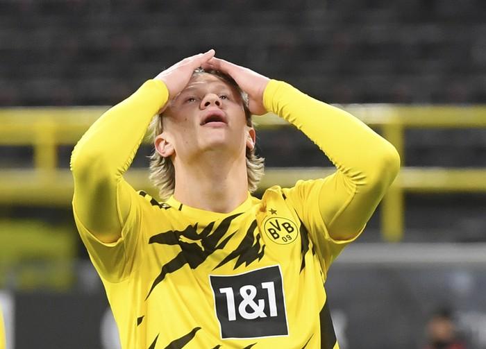 Dortmunds Erling Haaland reacts, during the German Bundesliga soccer match between Dortmund and Berlin Hertha, at Signal Iduna Park, in Dortmund, Germany, Saturday, March 13, 2021. (Bernd Thissen/Pool Photo via AP)