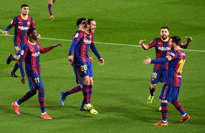 BARCELONA, SPAIN - MARCH 15: Oscar Mingueza of FC Barcelona celebrates with team mates (L - R) Ousmane Dembele, Jordi Alba and Lionel Messi after scoring their sides third goal during the La Liga Santander match between FC Barcelona and SD Huesca at Camp Nou on March 15, 2021 in Barcelona, Spain. Sporting stadiums around Spain remain under strict restrictions due to the Coronavirus Pandemic as Government social distancing laws prohibit fans inside venues resulting in games being played behind closed doors. (Photo by David Ramos/Getty Images)