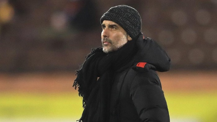 Manchester Citys head coach Pep Guardiola walks on the pitch before an English Premier League soccer match between Fulham and Manchester City at the Craven Cottage stadium in London, England, Saturday March 13, 2021. (Adam Davy/Pool via AP)
