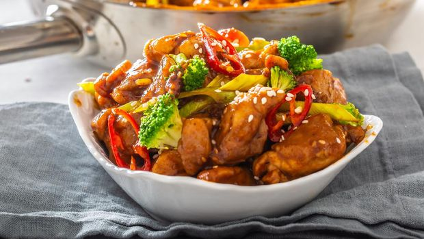 Ayam Kecap. Chicken cooked or stew in thick sweet soy sauce and spices. Served with rice