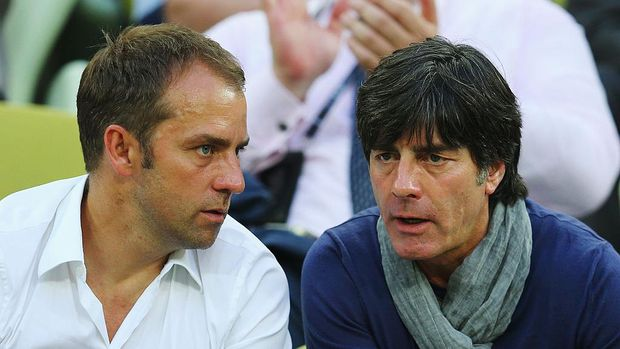 GDANSK, POLAND - JUNE 18:  Joachim Loew (R), head coach of Germany and assistant coach Hansi Flick look on during the UEFA EURO 2012 group C match between Croatia and Spain at The Municipal Stadium on June 18, 2012 in Gdansk, Poland.  (Photo by Alex Grimm/Getty Images)