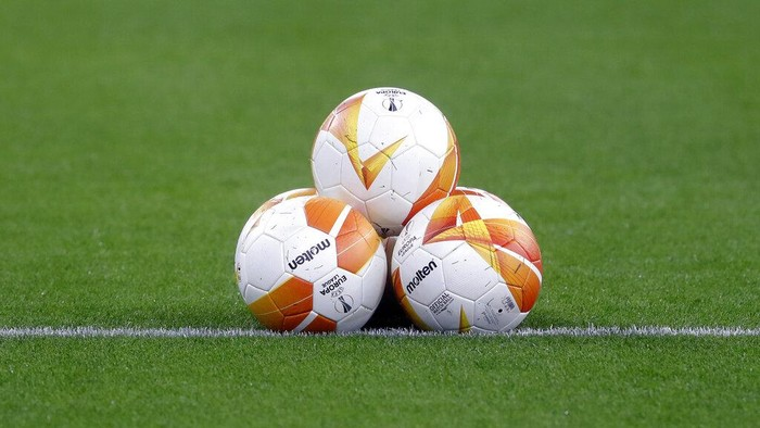 Balls are placed on the pitch ahead of the Europa League, round of 16, second leg soccer match, between Granada and Molde FK at the Puskas Arena stadium in Budapest, Hungary, Thursday, March 18, 2021. (AP Photo/Laszlo Balogh)