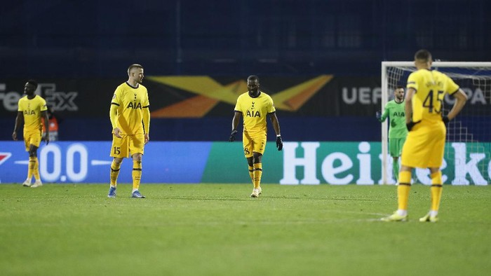 Tottenham Hotspur players react after Dinamo Zagrebs Mislav Orsic scores his sides third goal during the Europa League round of 16 second leg soccer match between Dinamo Zagreb and Tottenham Hotspur at the Maksimir stadium in Zagreb, Croatia, March 18, 2021. (AP Photo/Darko Bandic)