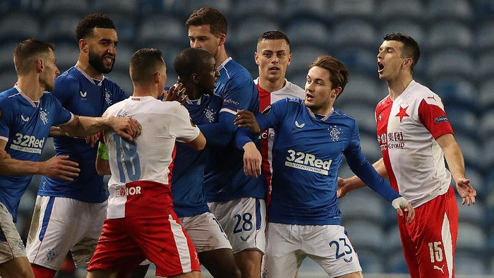 GLASGOW, SCOTLAND - MARCH 18: Glen Kamara of Rangers clashes with Ondrej Kudela of Slavia Praha during the UEFA Europa League Round of 16 Second Leg match between Rangers and Slavia Praha at Ibrox Stadium on March 18, 2021 in Glasgow, Scotland. Sporting stadiums around Europe remain under strict restrictions due to the Coronavirus Pandemic as Government social distancing laws prohibit fans inside venues resulting in games being played behind closed doors. (Photo by Ian MacNicol/Getty Images)