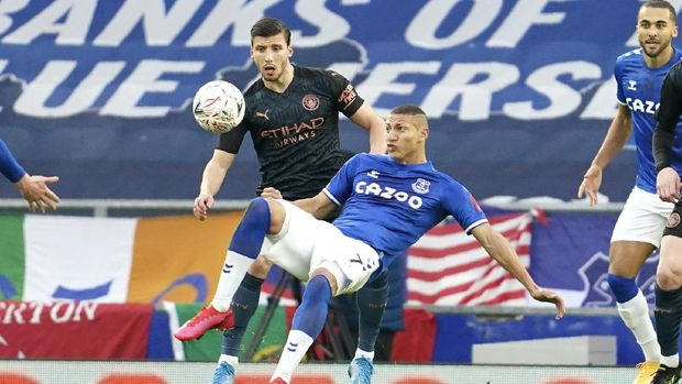 Manchester City's Ruben Dias, left, and Everton's Richarlison challenge for the ball during the English FA Cup sixth round soccer match between Everton and Manchester City at Goodison Park in Liverpool, England, Saturday, March 20, 2021. (AP Photo/Jon Super, Pool)