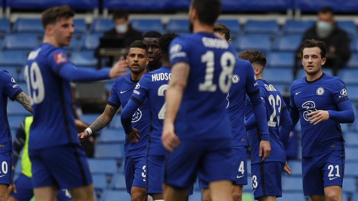 Chelsea players celebrate after Sheffield Uniteds Oliver Norwood scored an own goal during the English FA Cup quarterfinal soccer match between Chelsea and Sheffield United at the Stamford Bridge stadium in London, Sunday, March 21, 2021. (AP Photo/Kirsty Wigglesworth)