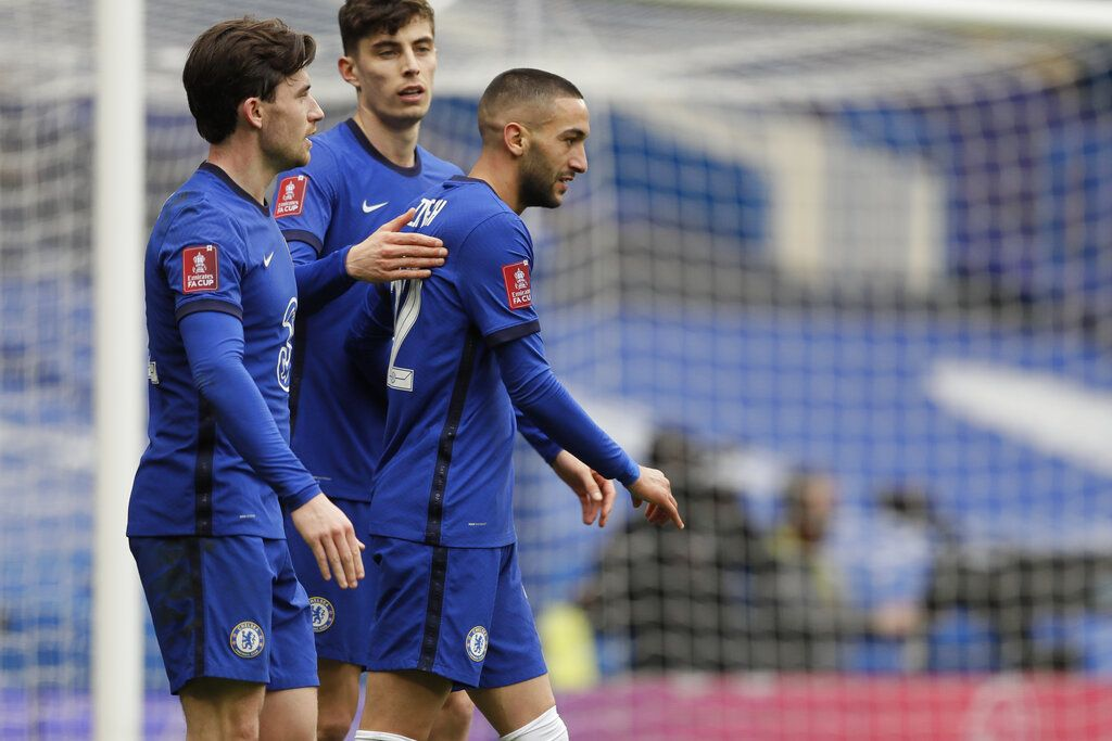 Chelsea's Hakim Ziyech, center, celebrates after scoring his side's second goal during the English FA Cup quarterfinal soccer match between Chelsea and Sheffield United at the Stamford Bridge stadium in London, Sunday, March 21, 2021. (AP Photo/Kirsty Wigglesworth)