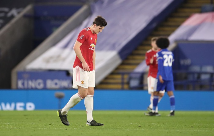 LEICESTER, ENGLAND - MARCH 21: Harry Maguire of Manchester United looks dejected after the Emirates FA Cup Quarter Final  match between Leicester City and Manchester United at The King Power Stadium on March 21, 2021 in Leicester, England. Sporting stadiums around the UK remain under strict restrictions due to the Coronavirus Pandemic as Government social distancing laws prohibit fans inside venues resulting in games being played behind closed doors.  (Photo by Alex Pantling/Getty Images)