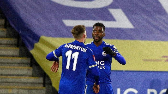 Leicesters Kelechi Iheanacho, right, celebrates with Leicesters Marc Albrighton after scoring his sides third goal during the English FA Cup quarter final soccer match between Leicester City and Manchester United at the King Power Stadium in Leicester, England, Sunday, March 21, 2021. (AP Photo/Ian Walton, Pool)