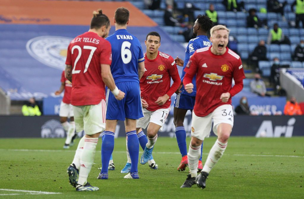 LEICESTER, ENGLAND - MARCH 21: Mason Greenwood of Manchester United celebrates after scoring their side's first goal during the Emirates FA Cup Quarter Final  match between Leicester City and Manchester United at The King Power Stadium on March 21, 2021 in Leicester, England. Sporting stadiums around the UK remain under strict restrictions due to the Coronavirus Pandemic as Government social distancing laws prohibit fans inside venues resulting in games being played behind closed doors.  (Photo by Alex Pantling/Getty Images)