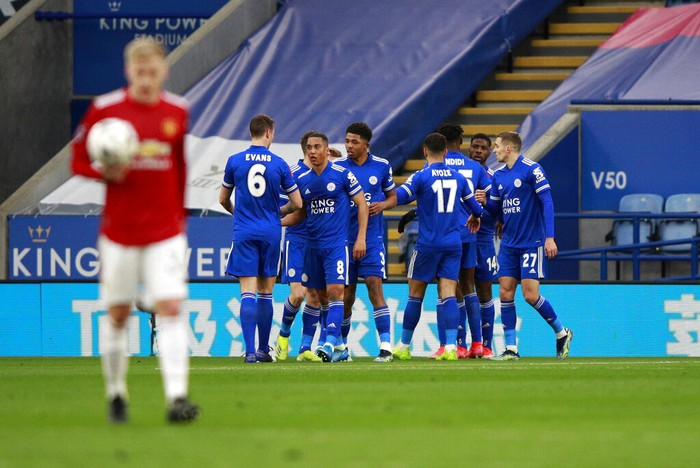 Leicesters Kelechi Iheanacho celebrates with teammates after scoring his sides opening goal during the English FA Cup quarter final soccer match between Leicester City and Manchester United at the King Power Stadium in Leicester, England, Sunday, March 21, 2021. (AP Photo/Ian Walton, Pool)
