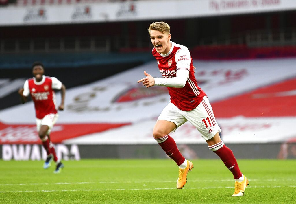 Arsenal's Martin Odegaard celebrates after scoring his side's opening goal during the English Premier League soccer match between Arsenal and Tottenham Hotspur at the Emirates stadium in London, England, Sunday, March 14, 2021. (Dan Mullan/Pool via AP)