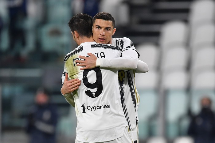 TURIN, ITALY - MARCH 02: Cristiano Ronaldo of Juventus celebrates with team mate Alvaro Morata after scoring their sides third goal during the Serie A match between Juventus and Spezia Calcio at Allianz Stadium on March 02, 2021 in Turin, Italy. Sporting stadiums around the Italy remain under strict restrictions due to the Coronavirus Pandemic as Government social distancing laws prohibit fans inside venues resulting in games being played behind closed doors. (Photo by Valerio Pennicino/Getty Images)