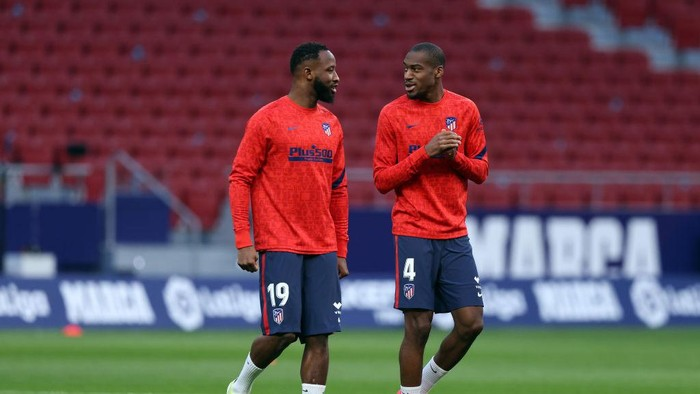 MADRID, SPAIN - MARCH 10: Moussa Dembele (L) of Atletico de Madrid speaks with team mate Geoffrey Kondogbia during the warm up prior to the La Liga Santander match between Atletico de Madrid and Athletic Club at Estadio Wanda Metropolitano on March 10, 2021 in Madrid, Spain. Sporting stadiums around Spain remain under strict restrictions due to the Coronavirus Pandemic as Government social distancing laws prohibit fans inside venues resulting in games being played behind closed doors. (Photo by Angel Martinez/Getty Images)