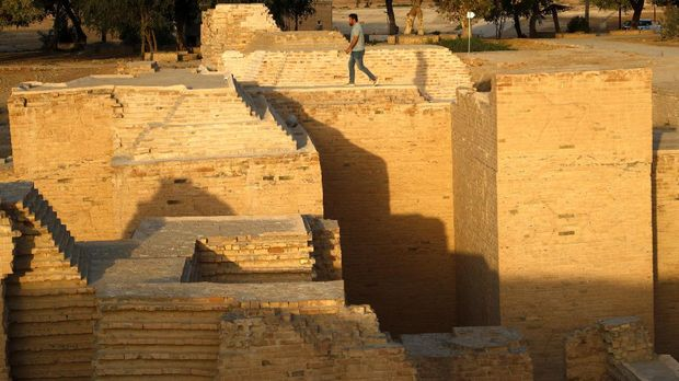 A man visits the archaeological site of Babylon, Iraq, Sunday, March 21, 2021. (AP Photo/Hadi Mizban)