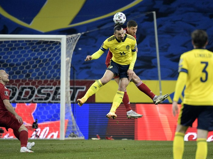 Swedens Zlatan Ibrahimovic, front center, and Georgias Lasha Dvali battle for the ball during World Cup 2022 qualifier group A soccer game between Sweden and Georgia at Friends Arena in Stockholm, Thursday March 25, 2021. (Pontus Lundahl/TT News Agency via AP)