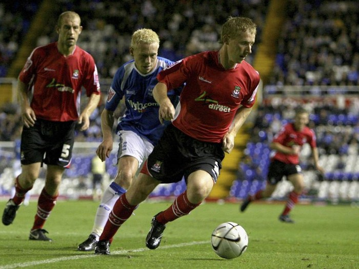 BIRMINGHAM, UNITED KINGDOM - SEPTEMBER 19: Lee Roche of Wrexham in action with Mikael Forssell of Birmingham City during the Carling Cup 2nd round match between  Birmingham City and Wrexham at St Andrews on September 19, 2006 in Birmingham, England.  (Photo by Clive Brunskill/Getty Images)