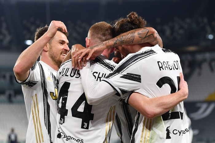 TURIN, ITALY - MARCH 06: Adrien Rabiot of Juventus celebrates with teammate Dejan Kulusevski and Aaron Ramsey  after scoring their team's first goal  during the Serie A match between Juventus  and SS Lazio at Allianz Stadium on March 06, 2021 in Turin, Italy. Sporting stadiums around Italy remain under strict restrictions due to the Coronavirus Pandemic as Government social distancing laws prohibit fans inside venues resulting in games being played behind closed doors. (Photo by Valerio Pennicino/Getty Images)