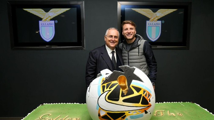 ROME, ITALY - MARCH 12: Ciro Immobile of SS Lazio poses with SS Lazio President Claudio Lotito, as he celebrates winning the Golden Boot Award with a special cake, after the Serie A match between SS Lazio and FC Crotone at Stadio Olimpico on March 12, 2021 in Rome, Italy. (Photo by Marco Rosi - SS Lazio/Getty Images)
