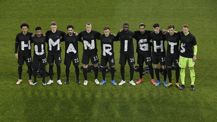 DUISBURG, GERMANY - MARCH 25: Players of Germany wear t-shirts which spell out
