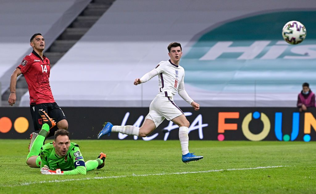 TIRANA, ALBANIA - MARCH 28: Mason Mount of England scores their side's second goal past Etrit Berisha of Albania during the FIFA World Cup 2022 Qatar qualifying match between Albania and England at the Qemal Stafa Stadium on March 28, 2021 in Tirana, Albania. Sporting stadiums around Europe remain under strict restrictions due to the Coronavirus Pandemic as Government social distancing laws prohibit fans inside venues resulting in games being played behind closed doors.  (Photo by Mattia Ozbot/Getty Images)