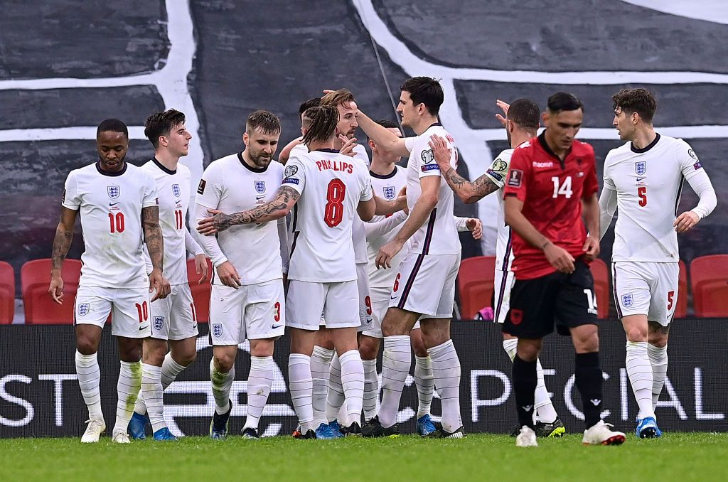 TIRANA, ALBANIA - MARCH 28: Harry Kane of England celebrates with Harry Maguire and team mates after scoring their side's first goal during the FIFA World Cup 2022 Qatar qualifying match between Albania and England at the Qemal Stafa Stadium on March 28, 2021 in Tirana, Albania. Sporting stadiums around Europe remain under strict restrictions due to the Coronavirus Pandemic as Government social distancing laws prohibit fans inside venues resulting in games being played behind closed doors.  (Photo by Mattia Ozbot/Getty Images)
