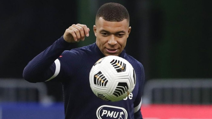 Frances Kylian Mbappe warms up before the World Cup 2022 group D qualifying soccer match between France and Ukraine at the Start de de France stadium, in Saint Denis, north of Paris, Wednesday, March 24, 2021. (AP Photo/Thibault Camus)