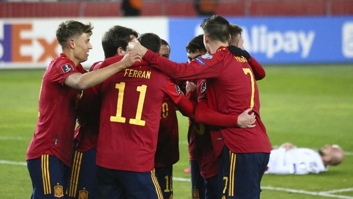 Spains players celebrates after scoring his sides second goal during the World Cup 2022 group B qualifying soccer match between Georgia and Spain at Boris Paichadze Dinamo Arena in Tbilisi, Georgia, Sunday, March 28, 2021. (AP Photo/Zurab Tsertsvadze)
