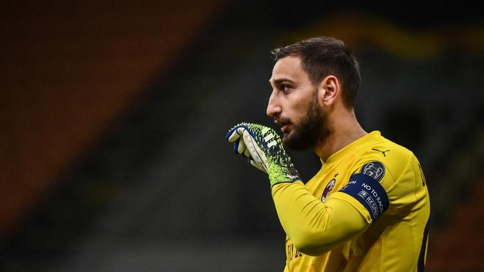 AC Milans Italian goalkeeper Gianluigi Donnarumma reacts during the UEFA Europa League round of 16 second leg football match between AC Milan and Manchester United at San Siro stadium in Milan on March 18, 2021. (Photo by Marco BERTORELLO / AFP)