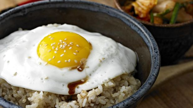 Fried Egg over Brown Rice with Soy Sauce and Sesame Seeds.