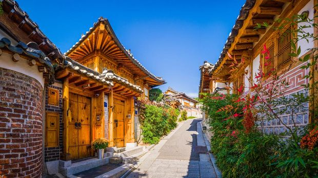 Traditional wooden framed houses along a pretty lane in the Bukchon Hanok village in Seoul, South Korea's vibrant capital city.