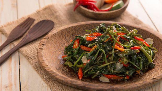 Closeup of cah kangkung, kangkong, or water spinach stirred.