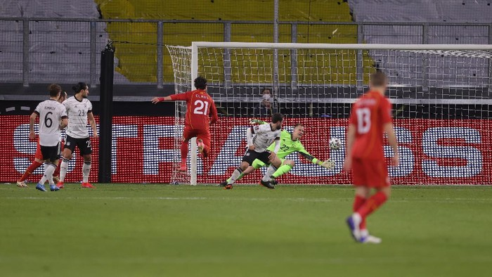 DUISBURG, GERMANY - MARCH 31: Eljif Elmas of North Macedonia scores their sides second goal during the FIFA World Cup 2022 Qatar qualifying match between Germany and North Macedonia at Schauinsland-Reisen-Arena on March 31, 2021 in Duisburg, Germany. Sporting stadiums around Germany remain under strict restrictions due to the Coronavirus Pandemic as Government social distancing laws prohibit fans inside venues resulting in games being played behind closed doors. (Photo by Alex Grimm/Getty Images)