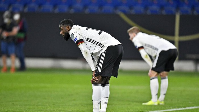 Germanys Antonio Ruediger stands on the pitch disappointed after losing the World Cup 2022 group J qualifying soccer match between Germany and North Macedonia in Duisburg, Germany, Wednesday, March 31, 2021. (AP Photo/Martin Meissner)